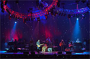 Mark Knopfler & Emmylou Harris distance stage shot with star lights